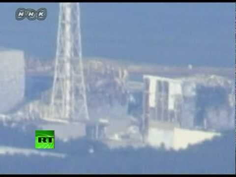 Video of helicopters water-bombing nuclear reactor, close-up shots of Fukushima
